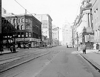 Hastings Street in 1954 courtesy of Wikipedia. A quick 'East Hastings Street' google image search will give you a feel of the area today